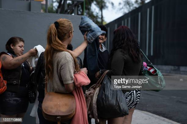 Nicky Castelan receives donated clothes from neighbors in the Buenavista neighborhood on June 23 2020 in Mexico City Mexico Nicky a HIV positive...