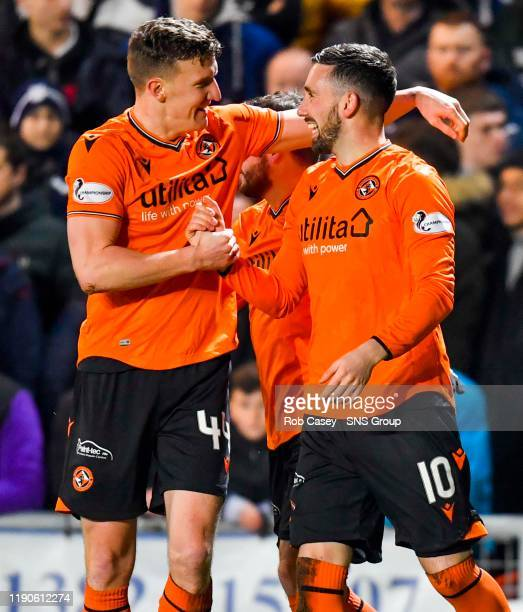 Nicky Clark celebrates with Paul Watson after scoring to make it 10 during the Ladbrokes Championship match between Dundee Utd and Dundee at...