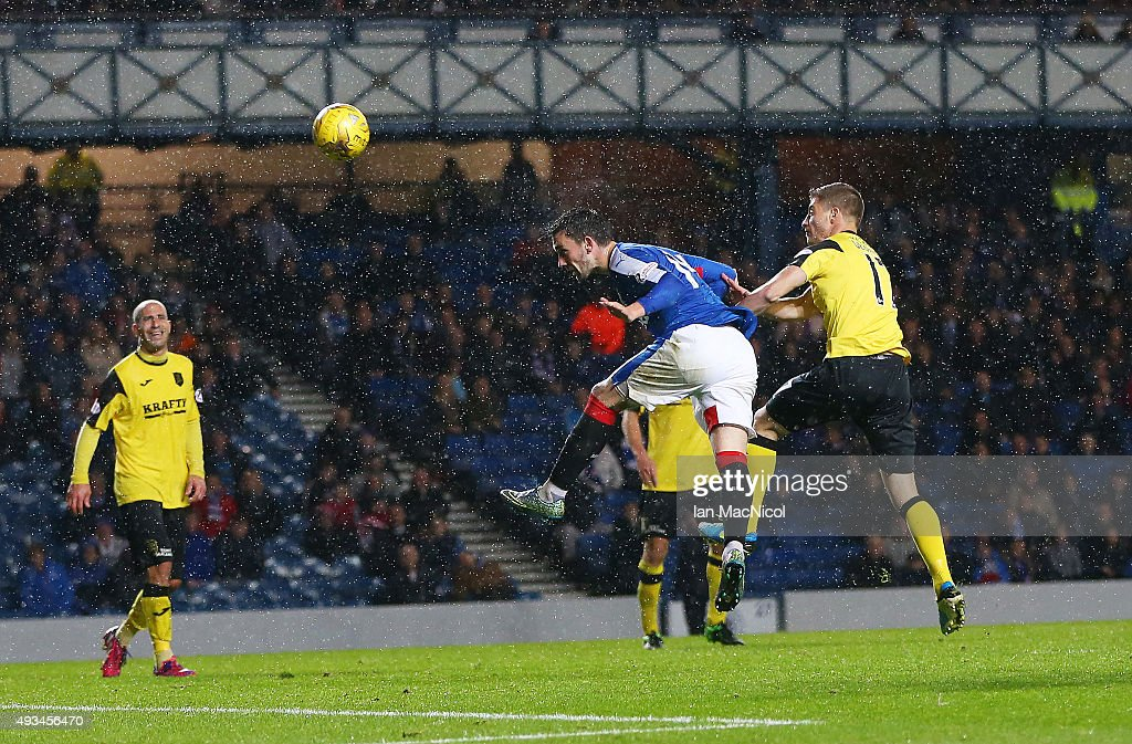 Nicky Clark of Rangers heads at goal during the Petrofac Training Cup Quarter-Final match between Rangers and Livingston at Ibrox Stadium on October 20, 2015 in Glasgow, Scotland.