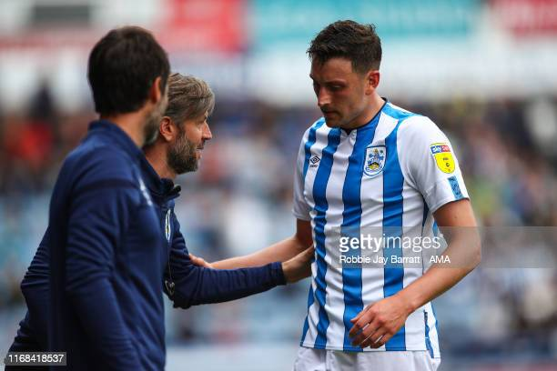 Nicky Cowley the assistant head coach / manager of Huddersfield Town and Tommy Elphick of Huddersfield Town during the Sky Bet Championship match...