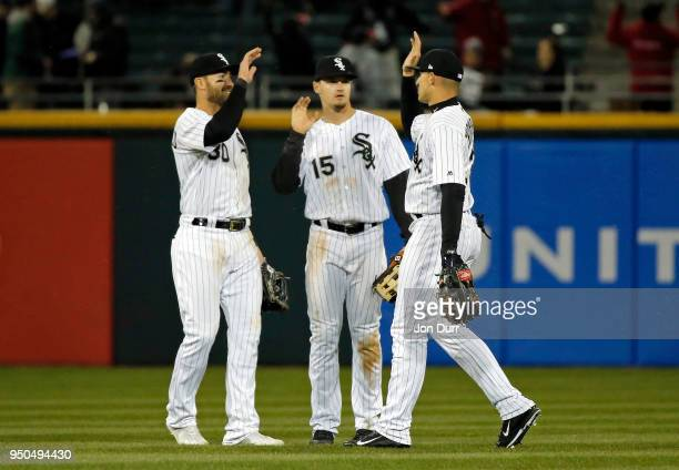 Nicky Delmonico of the Chicago White Sox Adam Engel and Trayce Thompson celebrate their win over the Seattle Mariners at Guaranteed Rate Field on...
