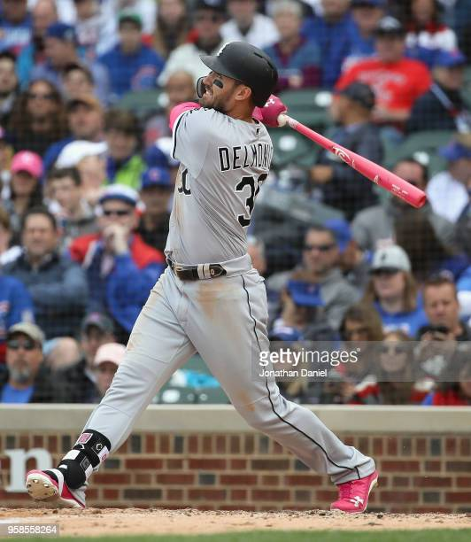 Nicky Delmonico of the Chicago White Sox bats against the Chicago Cubs at Wrigley Field on May 13 2018 in Chicago Illinois The White Sox defeated the...
