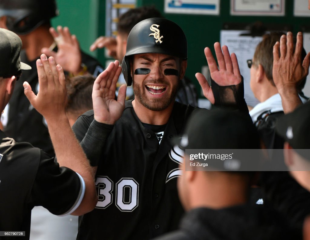 Nicky Delmonico #30 of the Chicago White Sox celebrates with teammates after scoring on Daniel Palka's two-run double in the fourth inning against the Kansas City Royals at Kauffman Stadium on April 29, 2018 in Kansas City, Missouri.