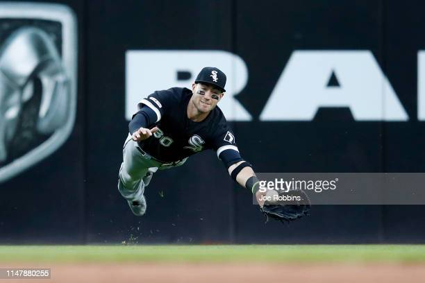 Nicky Delmonico of the Chicago White Sox dives but is not able to catch a line drive in the fourth inning against the Cleveland Indians at...