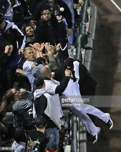 Nicky Delmonico of the Chicago White Sox dives into the stands trying to catch a foul ball hit by Francisco Lindor in the 2nd inning at Guaranteed...