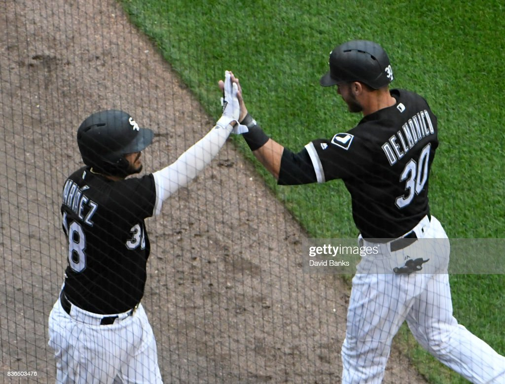 Nicky Delmonico #30 of the Chicago White Sox is greeted by Omar Narvaez #38 after scoring against the Minnesota Twins during the fifth inning in game one of a doubleheader on August 21, 2017 at Guaranteed Rate Field in Chicago, Illinois.