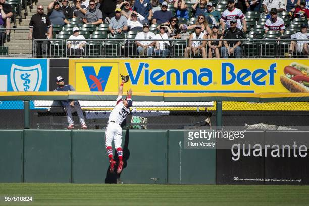 Nicky Delmonico of the Chicago White Sox takes a home run away with a spectacular catch on a ball hit by Eduardo Escobar of the the Minnesota Twins...