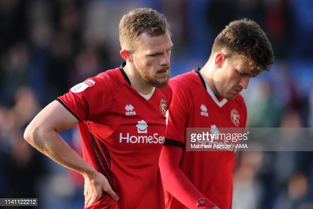 Nicky Devlin and Andy Cook of Walsall react as their team are relegated during the Sky Bet League One match between Shrewsbury Town and Walsall at...