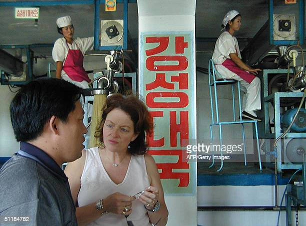 Nicky Downer the wife of Australian Foreign Minister Alexander Downer visits a food factory in Pyongyang 18 August 2004 supported by the United...