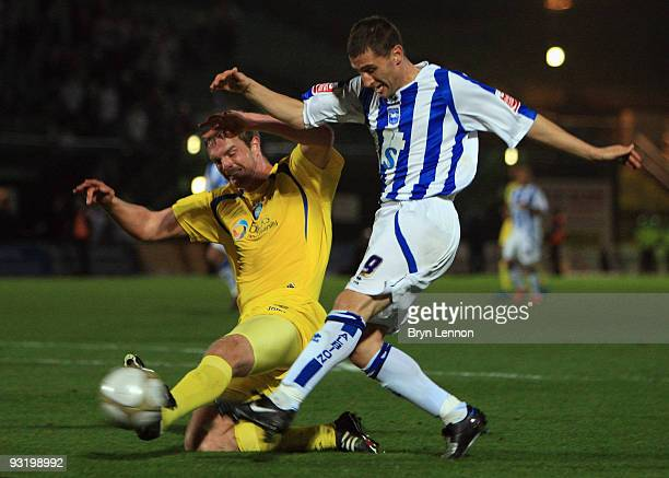 Nicky Forster of Brighton and Hove Albion challenges Luke Oliver of Wycombe Wanderers during the FA Cup 1st Round Replay between Brighton Hove Albion...