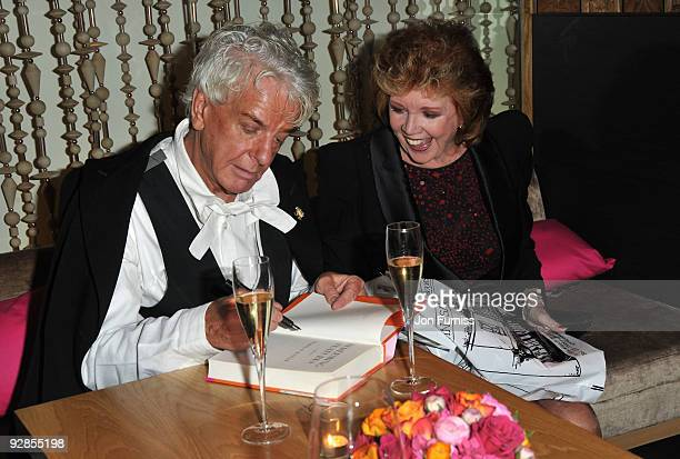 Nicky Haslam and Cilla Black attends the book launch party for Nicky Haslam's autobiography 'Redeeming Features' on November 5 2009 in London England