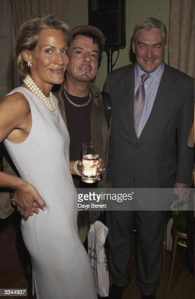 Nicky Haslam and Conrad Black and friend attend the SimonSebag Montefiore Red Tsar Book Launch Party at The Union Club in Mayfair on July 9 2003 in...