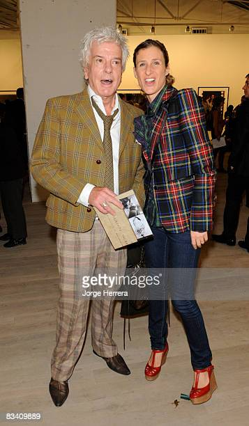 Nicky Haslam and Eliane Fattal attend a reception at an exhibition of work by Annie Leibovitz at Phillips de Pury on October 23 2008 in London England