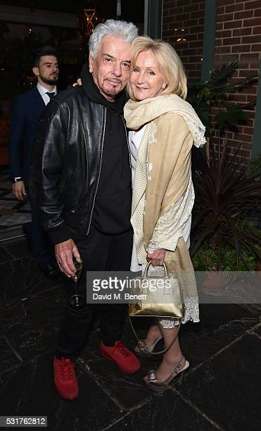 Nicky Haslam and Liz Brewer attend The Ivy Chelsea Garden's 'A Year In The Garden' party on May 16 2016 in London England