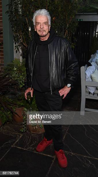 Nicky Haslam attends The Ivy Chelsea Garden's 'A Year In The Garden' party on May 16 2016 in London England