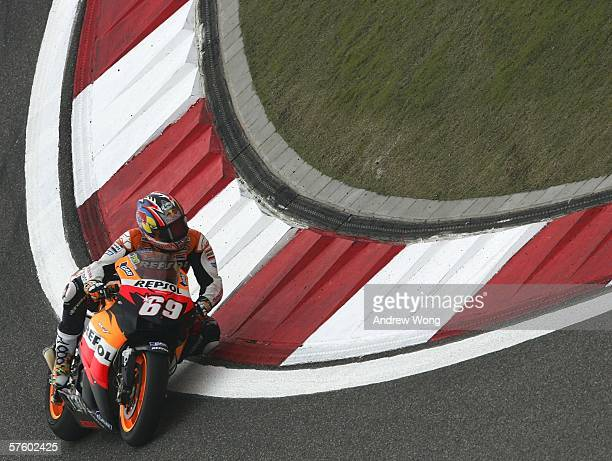 Nicky Hayden of Repsol Honda and United States turns a corner during the qualifying session for round four of MotoGP held at the Shanghai Circuit on...