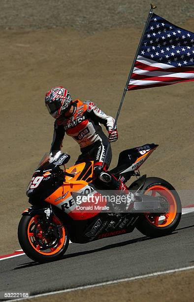 Nicky Hayden of the USA rides his Repsol Honda Team on a victory lap after winning the 2005 Red Bull US Grand Prix part of the MotoGP World...