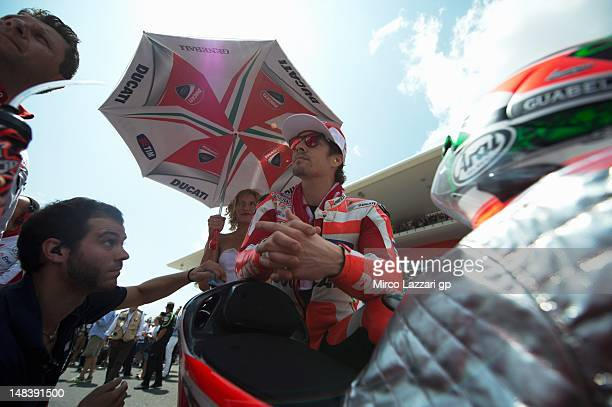 Nicky Hayden of USA and Ducati Marlboro Team looks on on the grid of the MotoGP race of the MotoGP of Italy at Mugello Circuit on July 15 2012 in...