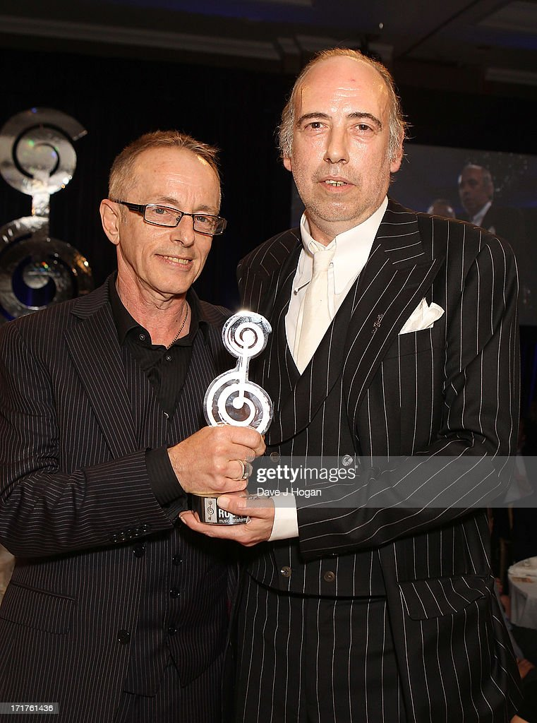 Nicky Headon and Mick Jones of Clash pose with The 02 Silver Clef Award at the Nordoff Robbins Silver Clef Awards at London Hilton on June 28, 2013 in London, England.