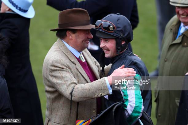 Nicky Henderson and Nico de Boinville celebrate after winning the Betway Queen Mother Champion Chase with Altior during Cheltenham Festival Ladies...