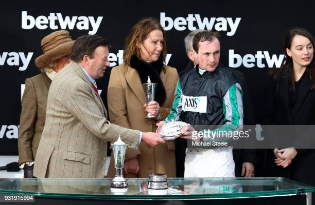 Nicky Henderson Camilla Duchess of Cornwall Mrs Patricia Pugh and Nico de Boinville celebrate after winning the Betway Queen Mother Champion Chase...