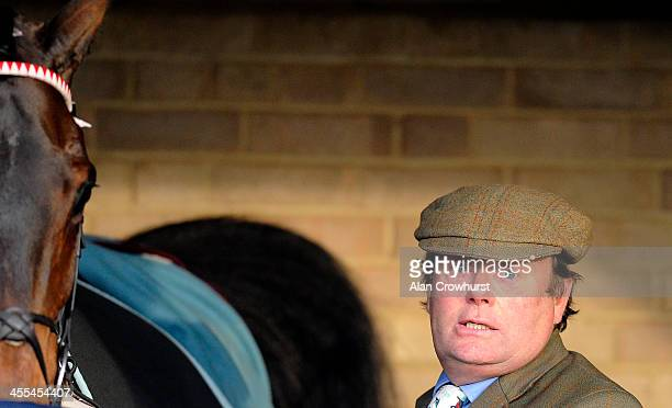 Nicky Henderson poses at Huntingdon racecourse on December 12 2013 in Huntingdon England