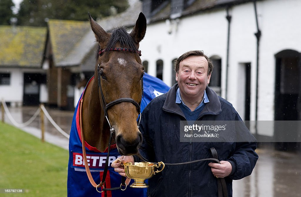 Nicky Henderson poses with Cheltenham Gold Cup winner Bobs Worth at Seven Barrows Stables on March 16, 2013 in Lambourn, England.