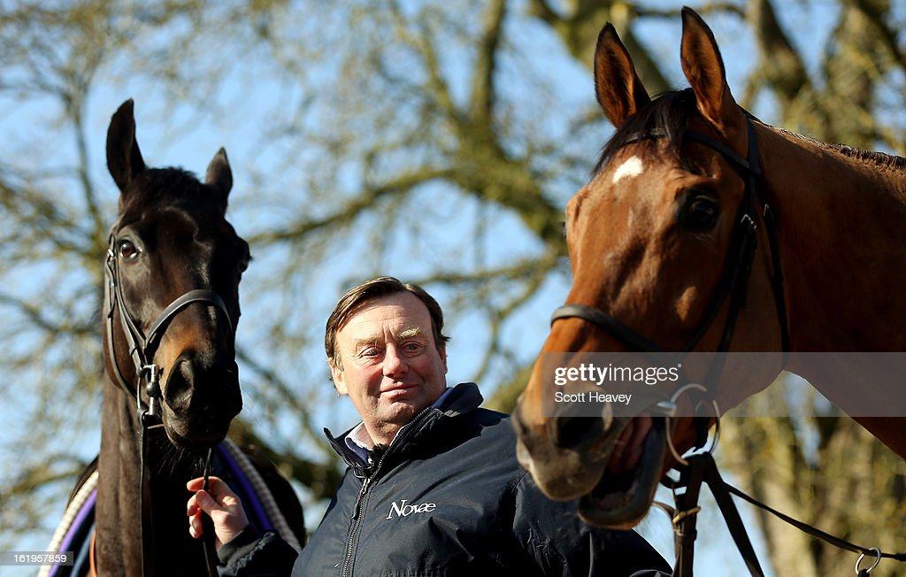 Nicky Henderson with Grandouet (L) and Binocular during a stable visit to Seven Barrows on February 18, 2013 in Lambourn, England.