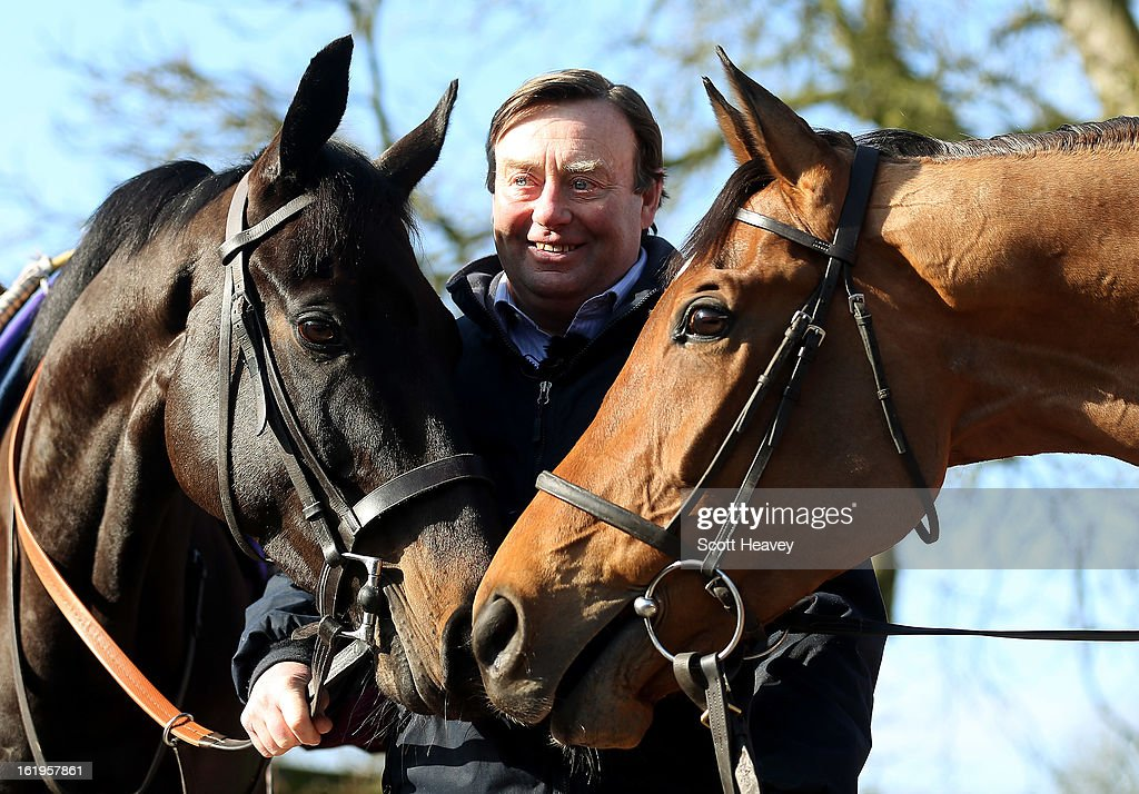 Nicky Henderson with Grandouet (L0 and Binocular during a stable visit to Seven Barrows on February 18, 2013 in Lambourn, England.