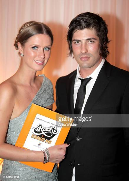 Nicky Hilton and actor Brandon Davis attend 17th Annual Race to Erase MS event cocktail reception cochaired by Nancy Davis and Tommy Hilfiger at the...