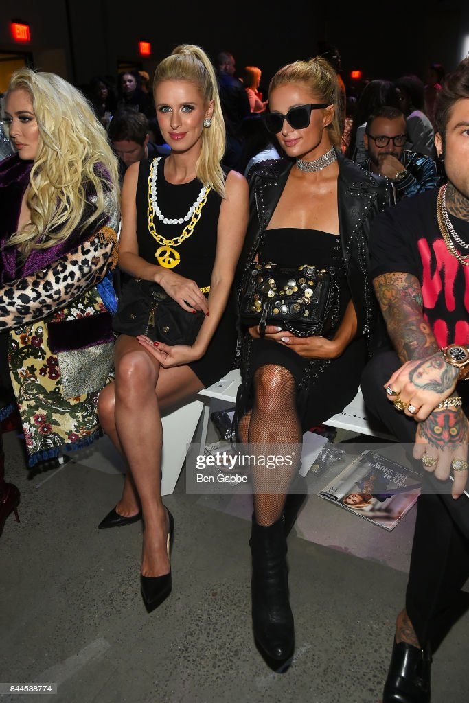 Nicky Hilton (L) and Paris Hilton attend the Jeremy Scott Fashion Show during New York Fashion Week at Spring Studios on September 8, 2017 in New York City.