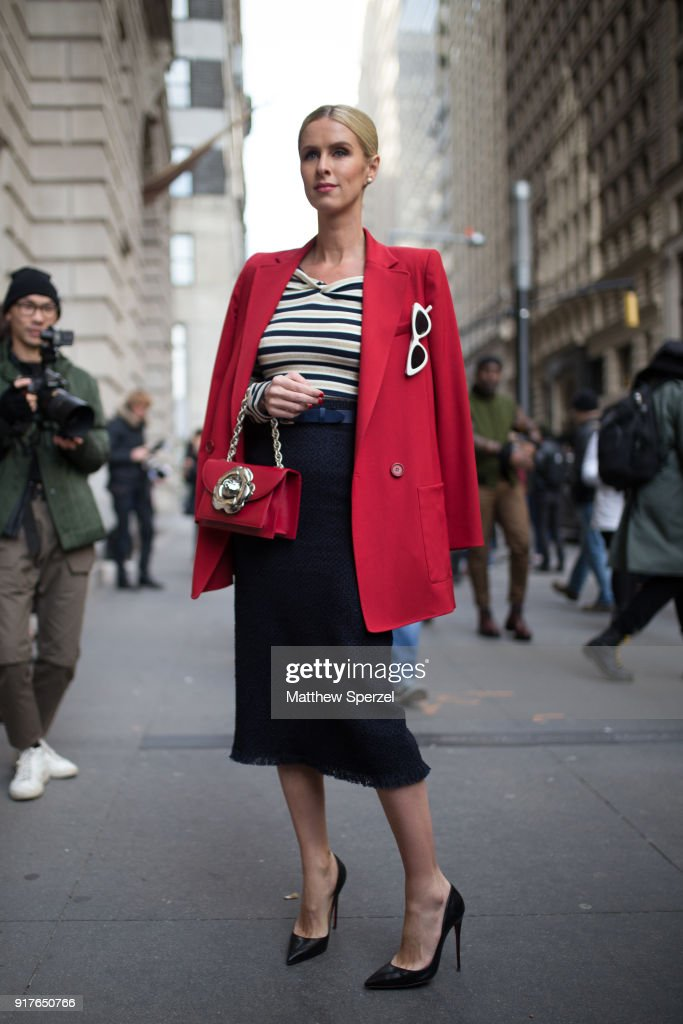 Nicky Hilton is seen on the street attending OSCAR DE LA RENTA during New York Fashion Week wearing a red blazer with striped top and black skirt on February 12, 2018 in New York City.