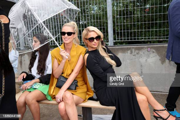 Nicky Hilton Rothschild and Paris Hilton attend the front row for Monse Resort 22 during NYFW: The Shows on September 09, 2021 in New York City.