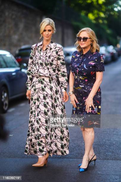 Nicky Hilton wears a pale pink dress with floral print ; Kathy Hilton wears a dark blue dress with multicolor printed features, blue shoes,...