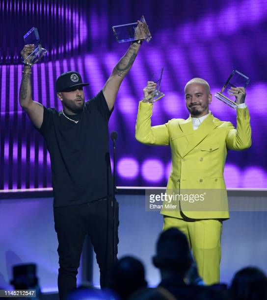 Nicky Jam and J Balvin accept the Airplay Song of the Year award for X during the 2019 Billboard Latin Music Awards at the Mandalay Bay Events Center...