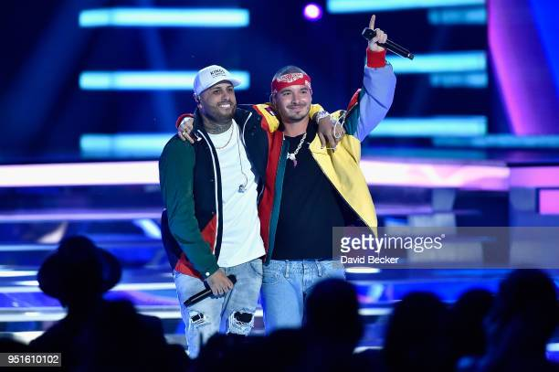 Nicky Jam and J Balvin perform onstage at the 2018 Billboard Latin Music Awards at the Mandalay Bay Events Center on April 26 2018 in Las Vegas Nevada