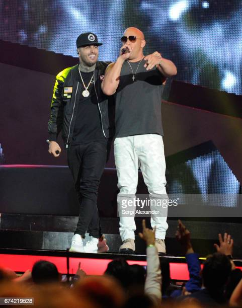 Nicky Jam and Vin Diesel perform onstage at the Billboard Latin Music Awards at Watsco Center on April 27 2017 in Coral Gables Florida