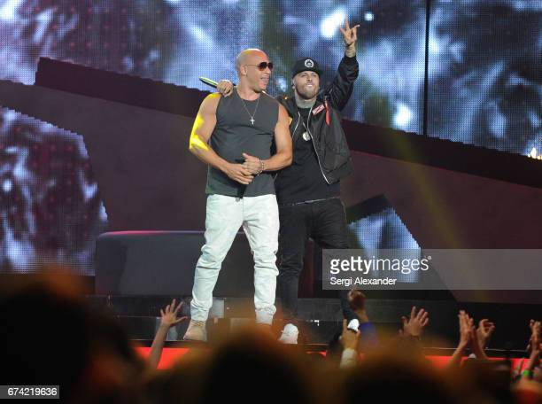 Nicky Jam and Vin Diesel performs onstage at the Billboard Latin Music Awards at Watsco Center on April 27 2017 in Coral Gables Florida