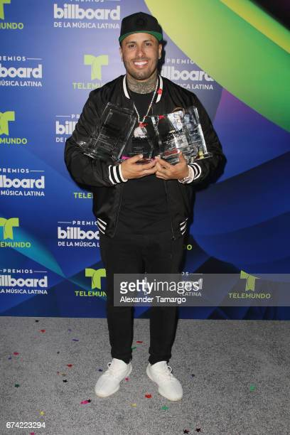 Nicky Jam poses with awards in the press room during the Billboard Latin Music Awards at Watsco Center on April 27 2017 in Coral Gables Florida