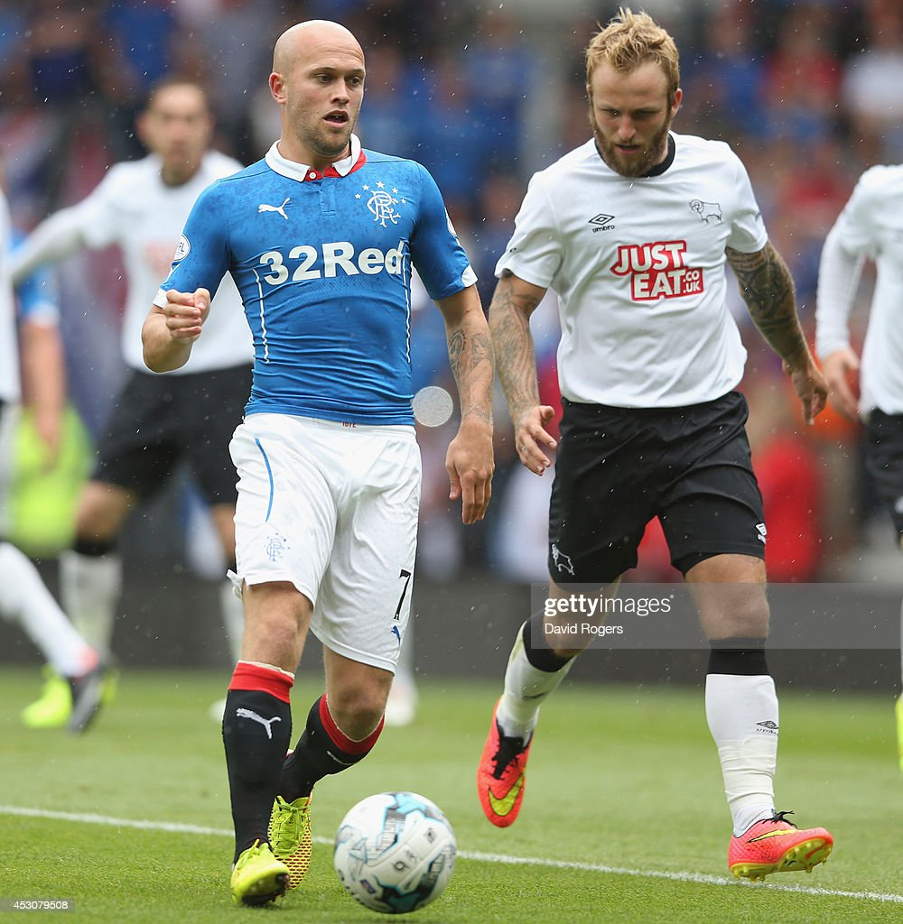 Nicky Law of Rangers runs with the ball during the pre season friendly match between Derby County and Rangers at iPro Stadium on August 2, 2014 in Derby, England.