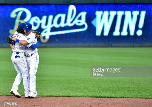 Nicky Lopez and Whit Merrifield of the Kansas City Royals celebrate a 3-1 win over the Detroit Tigers at Kauffman Stadium on September 27, 2020 in...