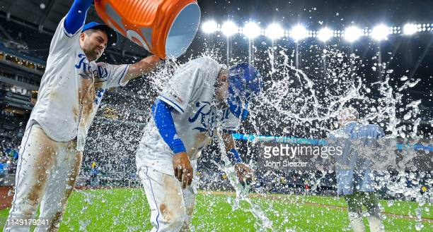 Nicky Lopez of the Kansas City Royals gets the victory shower from Whit Merrifield after the team's 115 win against the Texas Rangers in which Lopez...