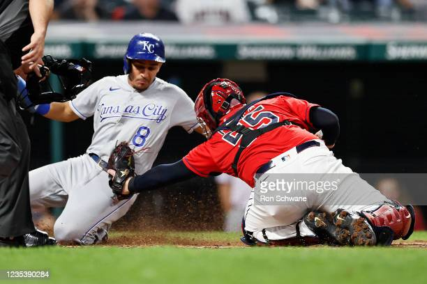 Nicky Lopez of the Kansas City Royals is tagged out at home plate by Roberto Perez of the Cleveland Indians in the third inning during game two of a...