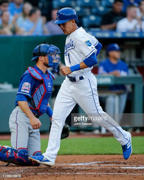 Nicky Lopez of the Kansas City Royals scores in front of Jeff Mathis of the Texas Rangers on a single by Adalberto Mondesi in the first inning during...