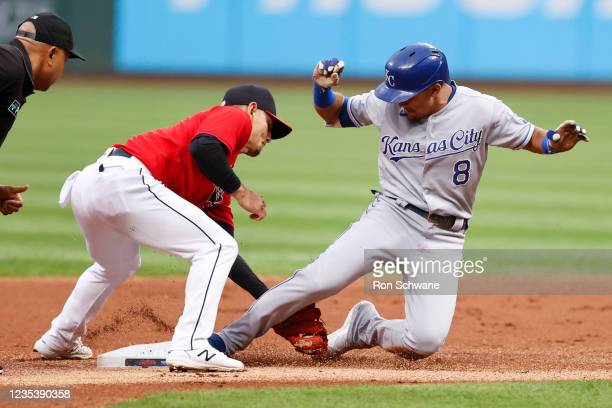 Nicky Lopez of the Kansas City Royals slides safely into second base with a double as Andres Gimenez of the Cleveland Indians covers in the first...
