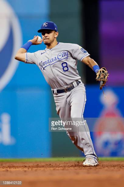 Nicky Lopez of the Kansas City Royals throws out Franmil Reyes of the Cleveland Indians at first base to complete a double play during the third...