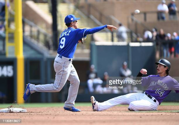 Nicky Lopez of the Kansas City Royals turns a double play as Tony Wolters of the Colorado Rockies slides into second base during the third inning of...