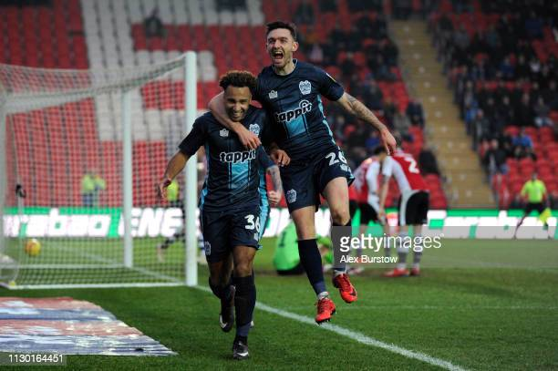 Nicky Maynard of Bury celebrates with teammate Jay O'Shea after scoring his team's first goal during the Sky Bet League Two match between Exeter City...