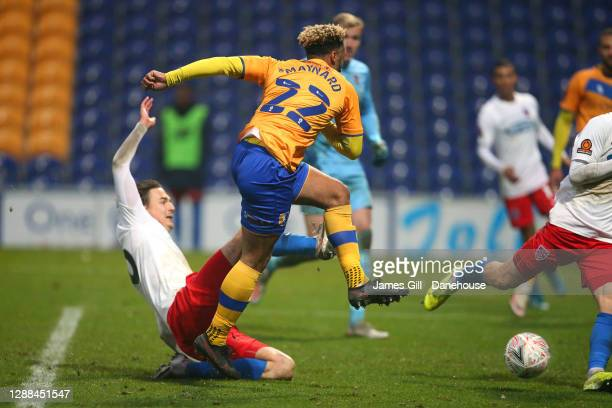 Nicky Maynard of Mansfield Town scores the winning goal during the FA Cup Second Round match between Mansfield Town and Dagenham and Redbridge at One...