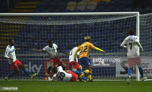Nicky Maynard of Mansfield Town scores their sides second goal during the Emirates FA Cup Second Round between Mansfield Town and Dagenham and...